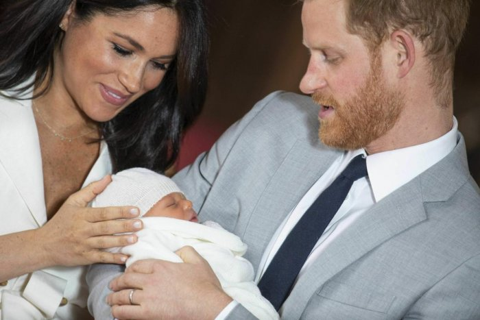 Britain's Prince Harry and Meghan, Duchess of Sussex, during a photocall with their newborn son, in St George's Hall at Windsor Castle. (AP/PTI Photo)
