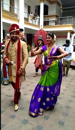 Bride Shruthi dances along with Yakshagana artistes while entering the marriage hall on the day of her wedding at Seshanayana Hall in Udupi. Groom Chethan is also seen.