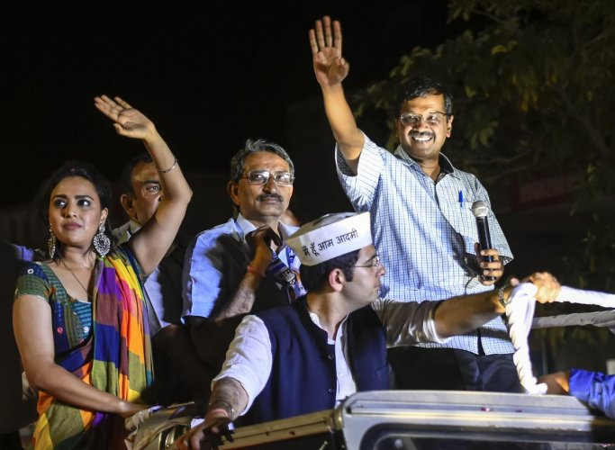 Delhi Chief Minister Arvind Kejriwal waves at his supporters during a roadshow in support of AAP party candidate from South Delhi constituency Raghav Chadha, for the ongoing Lok Sabha polls, at Chhatarpur, in New Delhi. (PTI Photo)