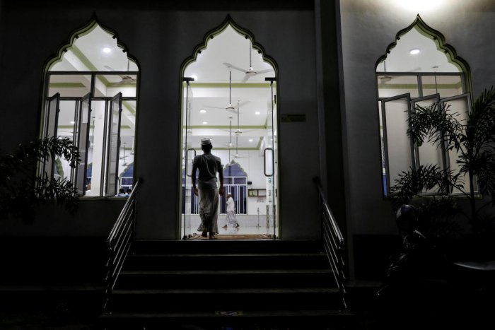 Muslims arrive at a mosque for evening prayers in Kattankudy, Sri Lanka. Reuters file photo