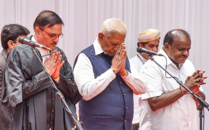 Governor Vajubhai R Vala administered the oath of office to Justice Oka at a ceremony held at the at Glass House in Raj Bhavan in the city. CM H D Kumaraswamy is also seen.