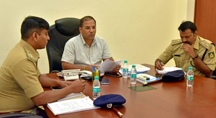 City Police Commissioner Sandeep Patil replies to a caller's question during the weekly phone-in programme in Mangaluru on Friday. DCP (Crime and Traffic) Lakshmi Ganesh and DCP (Law and order) Hanumantharaya look on.