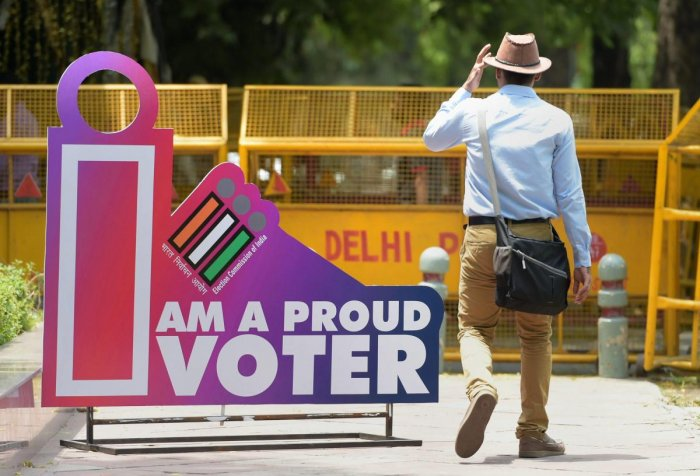 A man walk past a photo point installed at the Election Commission of India's headquarter on the eve of sixth phase polling for the Lok Sabha elections, in New Delhi, Saturday, May 11, 2019. Delhi will vote for its seven parliamentary seats on May 12. (PTI Photo)
