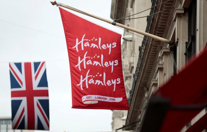 A flag flies outside the Hamleys toy shop in London. Reuters