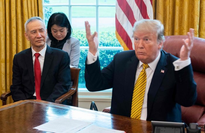 (FILES) In this file photo taken on April 4, 2019, US President Donald Trump (R) speaks during a trade meeting with China's Vice Premier Liu He (L) in the Oval Office at the White House in Washington, DC. - Trump urged patience in trade talks with China o