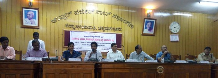 Deputy Commissioner Dr Bagadi Gautham speaks during a meeting held at Zilla Panchayat conference hall in Chikkamagaluru.