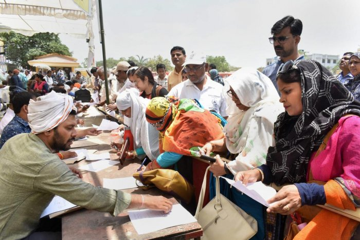 Polling officers collect EVMs ahead of the sixth phase of Lok Sabha polls, in Prayagraj. (PTI Photo)