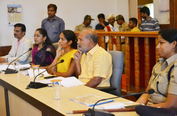 District In-charge Minister Sa Ra Mahesh chairs a meeting in Madikeri on Saturday.