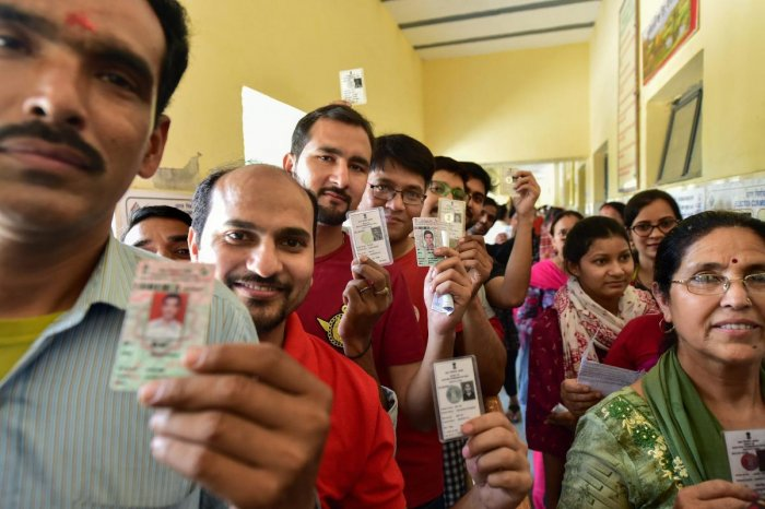 Voters wait outside a polling booth to cast their votes during the sixth phase of Lok Sabha elections 2019, at Baprola Nangloi, in West Delhi, Sunday, May 12, 2019. (PTI Photo)