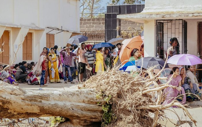 Cyclone Fani affected people wait to receive relief material being distributed by the Odisha government, in Bhubaneswar, Saturday, May 11, 2019. (PTI Photo)