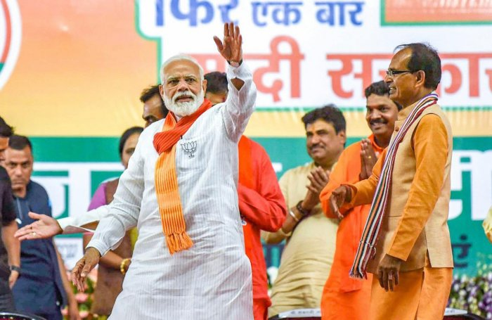 Prime Minister Narendra Modi waves at his supporters during an election campaign rally for the ongoing Lok Sabha polls, in Indore, Sunday, May 12, 2019. (PTI Photo)