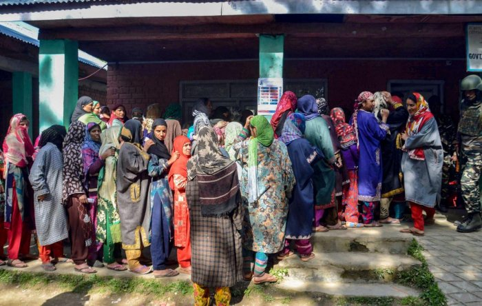 Women wait in long queues to cast their votes at a polling station, during the 4th phase of Lok Sabha elections, in Kulgam district of south Kashmir on April 29, 2019. (PTI Photo)