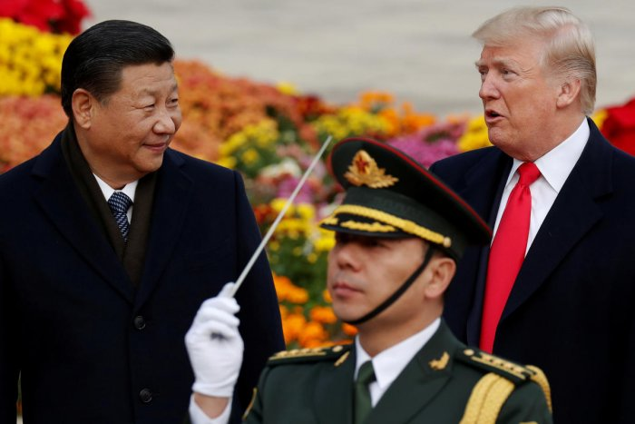 U.S. President Donald Trump takes part in a welcoming ceremony with China's President Xi Jinping at the Great Hall of the People in Beijing, China. (REUTERS)