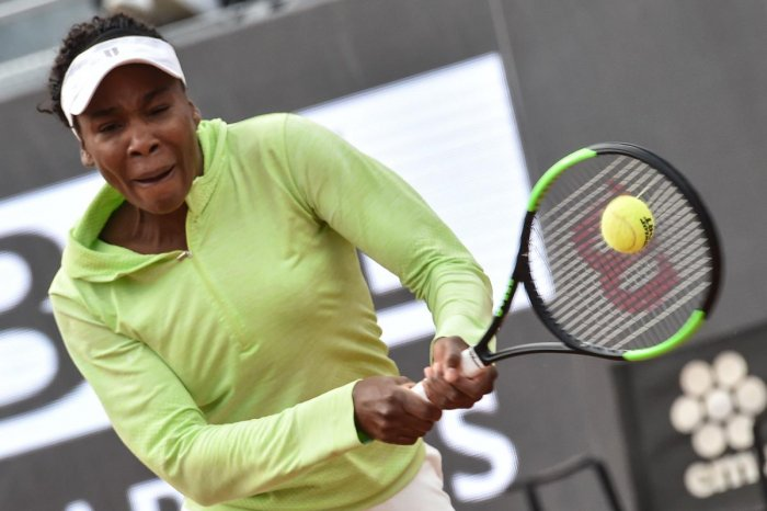 GUTSY: Venus Williams of the United States returns during her win over Belgium's Elise Mertens. AFP
