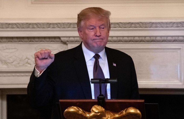 US President Donald Trump clenches his fist after speaking at an iftar, the meal that breaks the sunrise to sundown fast of Muslims celebrating Ramadan, at the White House in Washington DC on May 13, 2019. (AFP)