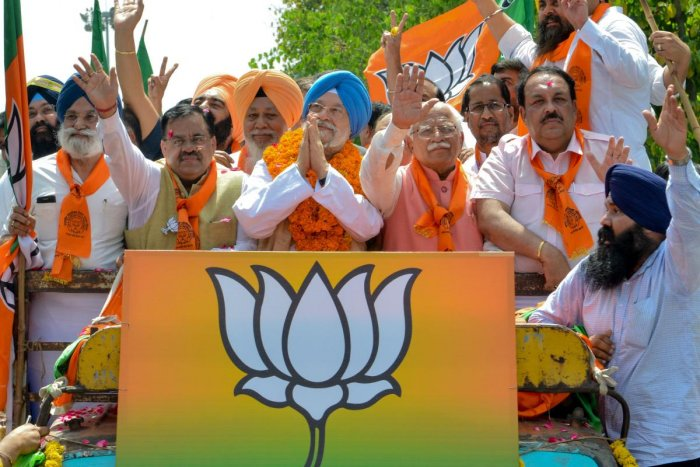 Union Minister and Bharatiya Janata Party (BJP) candidate for Amritsar's parliament seat Hardeep Singh Puri (C), Haryana Chief Minister Manohar Lal Khattar (C-R), BJP national secretary, Tarun Chugh (C-L), BJP Punjab Chief Shwait Malik (2R), gesture to po