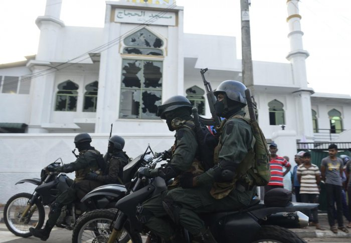Heavily-armed Sri Lankan soldiers ride a motorcycle in front of the Jumha Mosque after a mob attack in Minuwangida. (AFP File Photo)