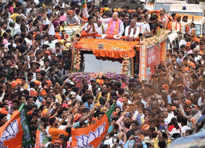 BJP National President Amit Shah during a roadshow for the last phase of Lok Sabha elections 2019, in Kolkata (PTI Photo)