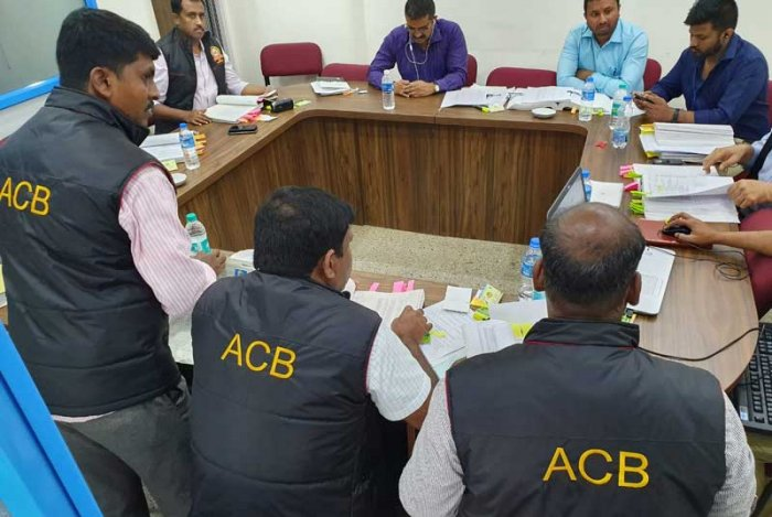 ACB sleuths search the premises of a co-operative bank in Bengaluru