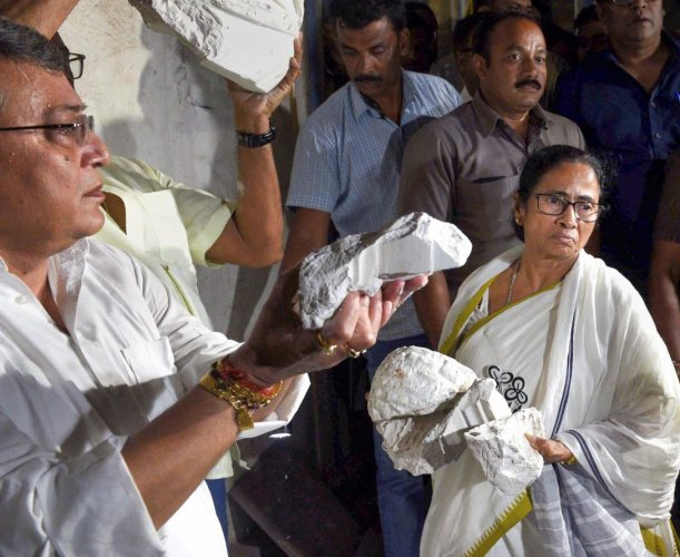 West Bengal Chief Minister Mamata Banerjee inspects the vandalised statue of Bengali writer and philosopher Ishwar Chandra Vidyasagar, after the clashes that broke out at BJP President Amit Shah's roadshow, in Kolkata, Tuesday night, May 14, 2019. (PTI photo)