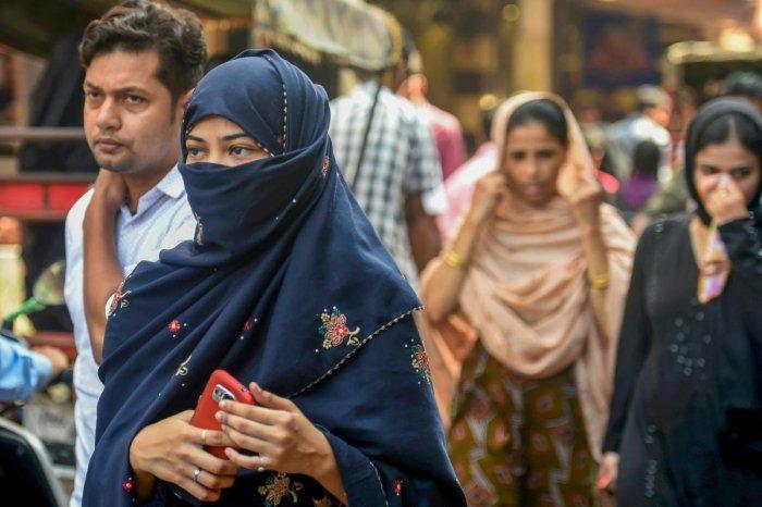New Delhi: A Muslim woman walks in a market, near Jama Masjid in New Delhi (Photo PTI)