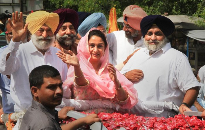 Union minister and Akali Dal candidate from Bathinda constituency Harsimrat Kaur Badal during an election roadshow for nomination papers filing ahead of Lok Sabha polls, in Bathinda, on April 26, 2019. Also seen is her husband and SAD president Sukhbir Si