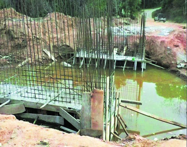The construction work of a bridge going at a snail's pace at Kalur village in Kodagu.