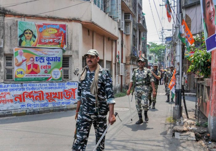 CRPF jawans conduct a route march ahead of the seventh and final phase of Lok Sabha elections, in Kolkata, Friday, May 17, 2019. (PTI Photo)