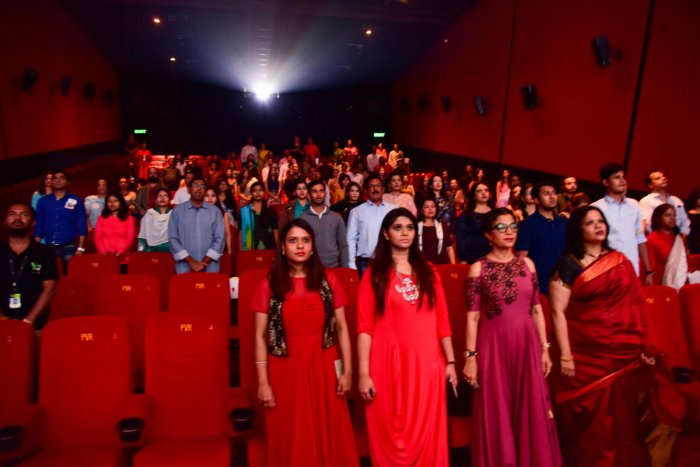 Audience at Vega City, Bannergatta Road, rise for the national anthem. dh photo by B H Shivakumar