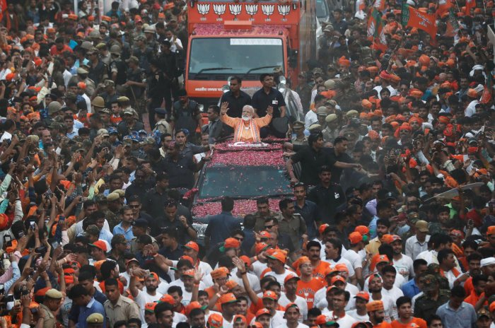 Prime Minister Narendra Modi waves towards his supporters during a roadshow in Varanasi, April 25, 2019. REUTERS