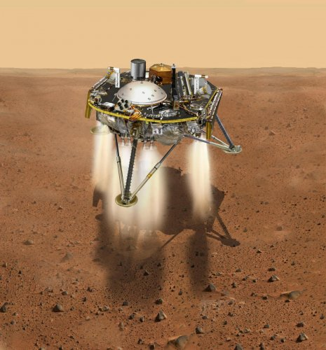 This NASA illustration recieved on November 21, 2018 shows a simulated view of NASA's Interior Exploration using Seismic Investigations, Geodesy and Heat Transport (InSight) lander firing retrorockets to slow down as it descends toward the surface of Mars
