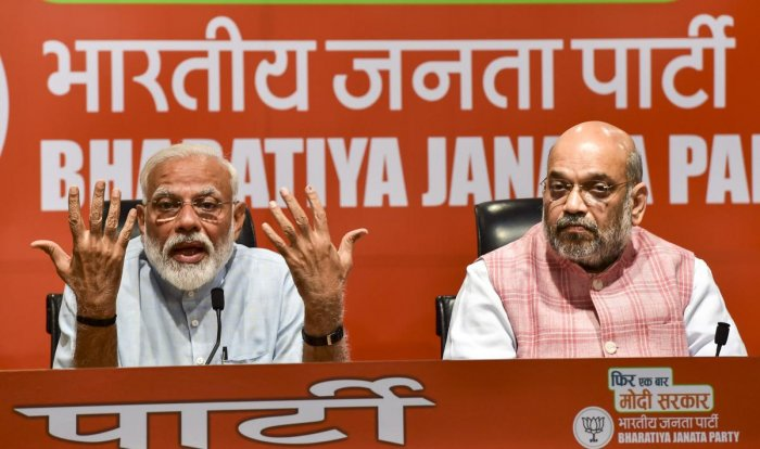 Prime Minister Narendra Modi and BJP president Amit Shah during a press conference in New Delhi on Friday. PTI