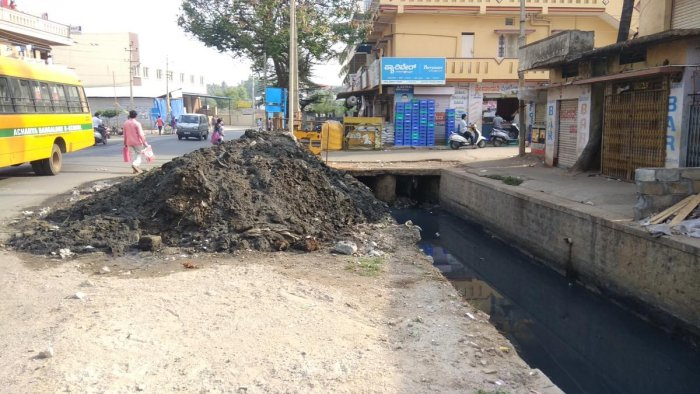 Silt from drain removed but pushed back by pre-monsoon showers