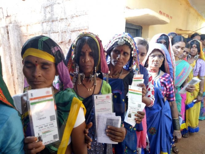 Lambani women wait in line to cast their votes for byelection to Chincholi Assembly segment at Shadipur Tanda. (DH Photo)
