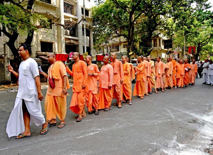Monks from the International Society for Krishna Consciousness (ISKCON), a Hindu religious organisation, queue to cast their votes at La Martiniere for Boys school in Kolkata. AFP photo