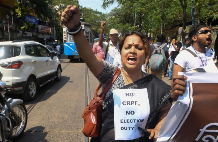 Indian school teachers selected as polling station officials shout slogans against the government and election commission as they demand security forces be posted at voting booths to ensure safety in the upcoming general election in Kolkata on April 8, 20