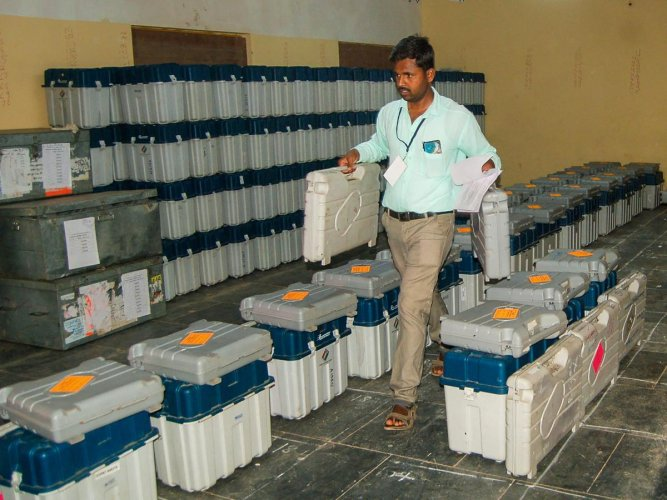 Kundgol: An election official inspects polling materials ahead of the byelection for Kundgol Assembly seat and the seventh and last phase of Lok Sabha polls, in Kundgol (PTI Photo)
