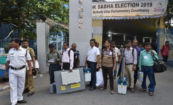 Kolkata: Election officials wait for a bus with EVM, VVPAT machines and other equipments ahead of the seventh and last phase of Lok Sabha polls, in Kolkata. (Photo PTI