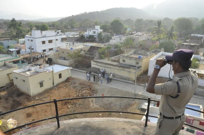 A security personnel keeps vigil in the Chandragiri Assembly constituency.