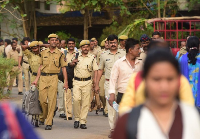 Indian Police personnel and other officials get ready ahead of 7th phase of elections. (AFP File Photo)