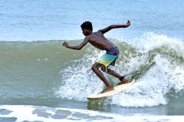 Selva, a young surfer, in action.