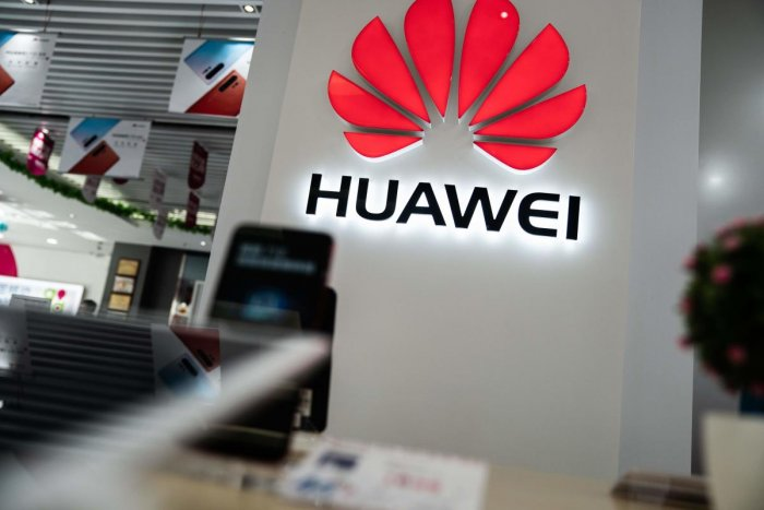 A Huawei logo is displayed at a retail store in Beijing on May 20, 2019. (AFP)