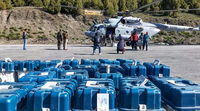 EVMs and VVPAT machines being unloaded from a Border Security Force helicopter at Stingri helipad for further transportation to the strong room in Lahaul and Spiti district on May 20, 2019. (PTI Photo)