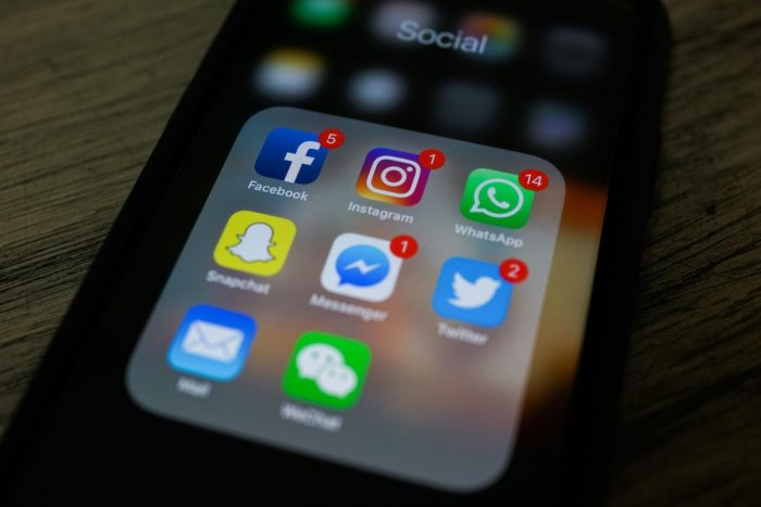 This photo illustration shows apps for Facebook, Instagram, Twitter and other social networks on a smartphone. (Photo by AFP PHOTO)