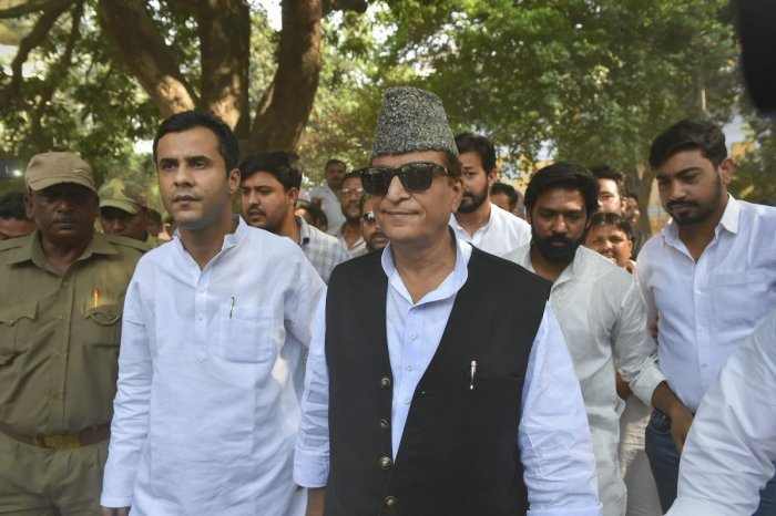 Samajwadi Party (SP) candidate from Rampur, Azam Khan, and his son Adeeb Azam Khan arrive to cast their vote, during the third phase of the 2019 Lok Sabha elections. (PTI File Photo)