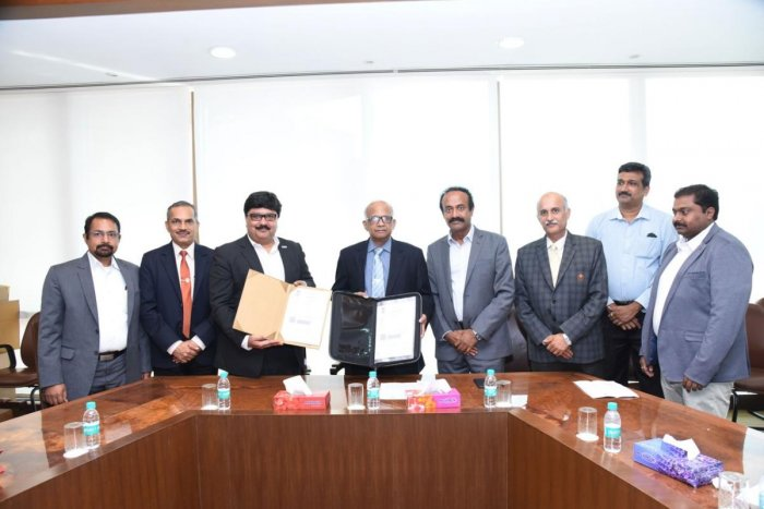 MAHE Vice Chancellor Dr H Vinod Bhat and Toyota Vice President Mr Naveen Soni exchange a memorandum of understanding.