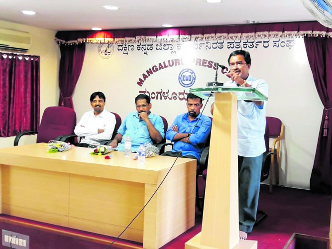 Dr Shrisha Kumar, professor at Vivekananda College, Puttur, speaks at an interaction on 'Drought, What Next?' organised by the Dakshina Kannada Working Journalists' Association in Mangaluru on Tuesday.
