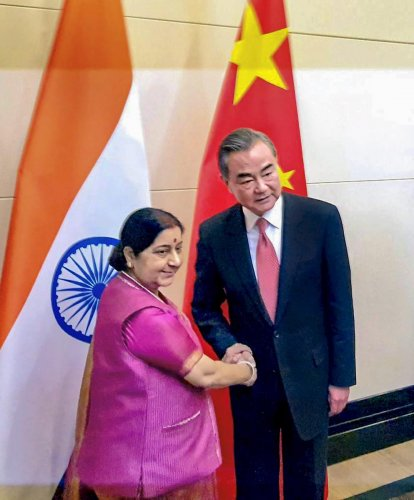 External Affairs Minister Sushma Swaraj meets Foreign Minister of China Wang Yi on the sidelines of the meeting of Shanghai Cooperation Organisation (SCO) Council of Foreign Ministers in Bishkek, Kyrgyzstan on Wednesday. PTI photo