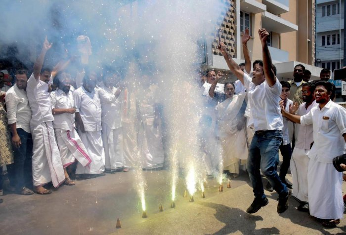 LS Polls 2019: Counting Day Kochi: United Democratic Front supporters celebrate the party's decisive lead in the 2019 Lok Sabha polls, outside the party office in Kochi, Thursday, May 23, 2019. (PTI Photo)