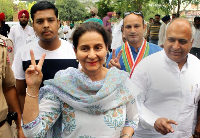 Congress candidate from Patiala seat Preneet Kaur flashes the victory sign along with the supporters as she arrives at a counting centre for the Lok Sabha polls 2019, on the vote counting day in Patiala. (PTI Photo)